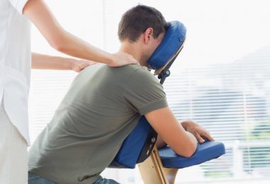physiotherapist-giving-shoulder-massage-to-man