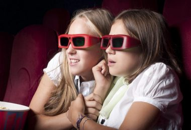 two-beautiful-girls-watching-a-movie-at-the-cinema
