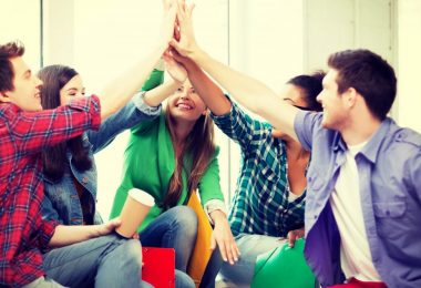 students-giving-high-five-at-school