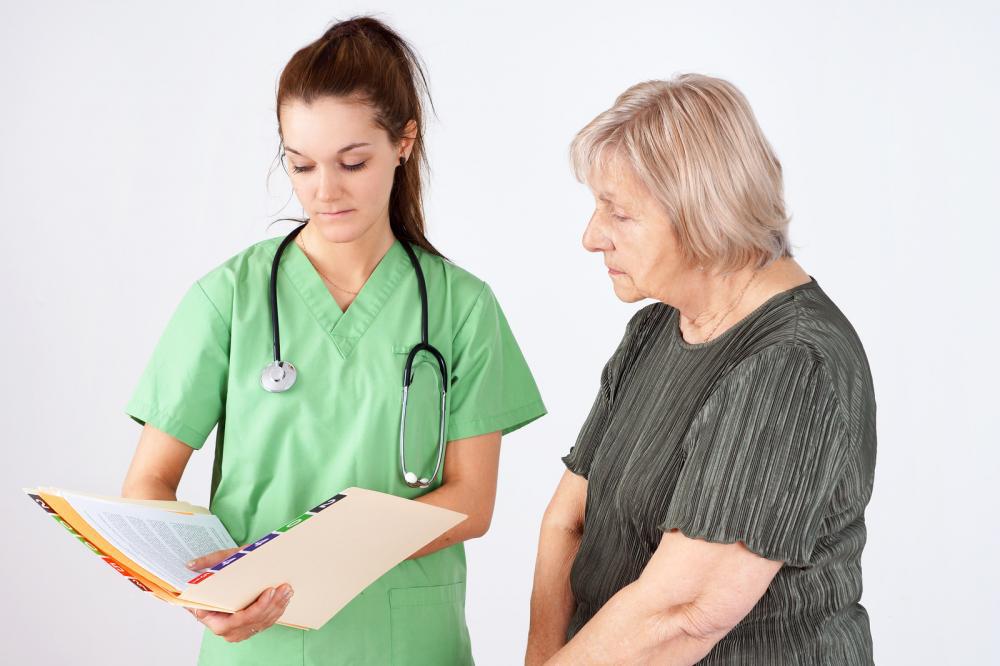 nurse and senior reading medical file