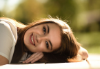 woman laying on table smiling