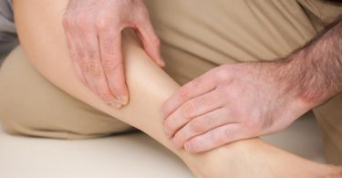 physiotherapist-massaging-the-shin-bone