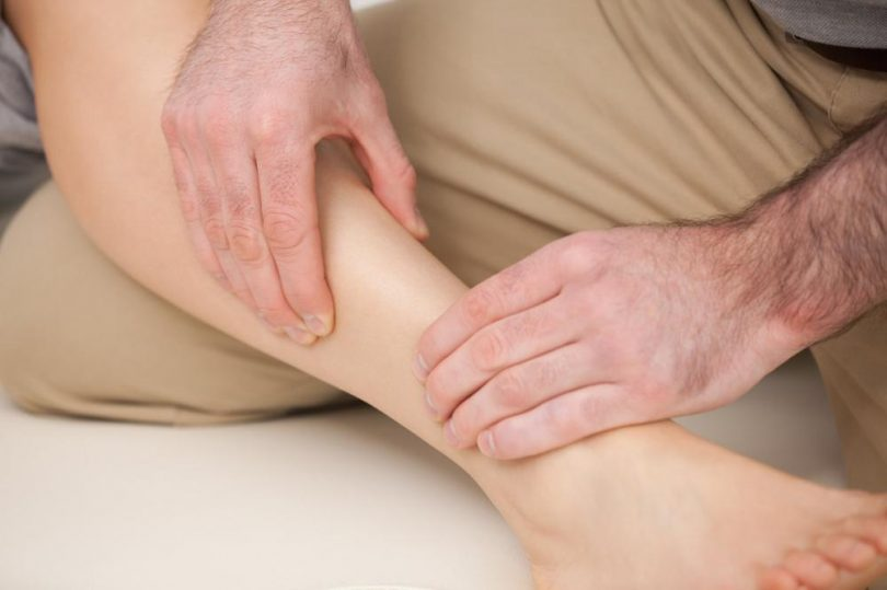 physiotherapist-massaging-the-shin-bone