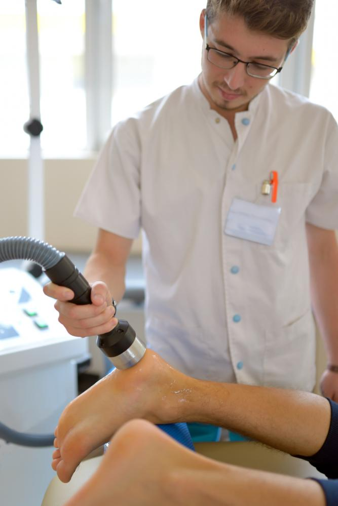 physiotherapist-performs-ultrasound-therapy-treatment