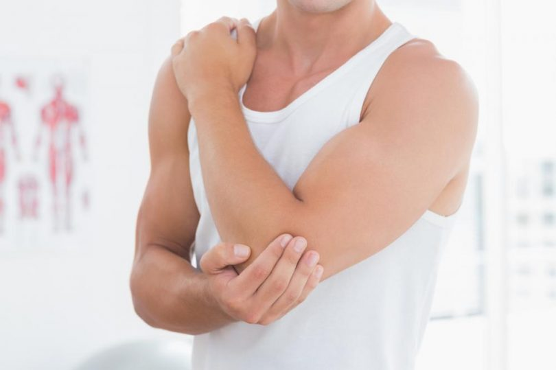 young-man-suffering-from-elbow-pain