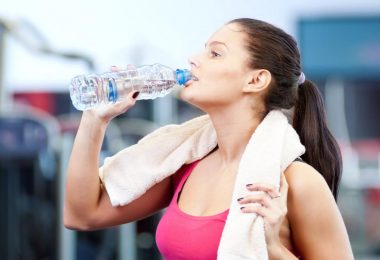 man-and-woman-drinking-water-after-sports