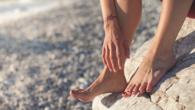 A person's feet on a rock