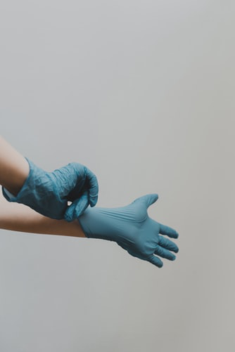 When cleaning, it's essential to wear gloves regardless of the environment. This helps prevent the transfer and transmission of viruses and bacteria.