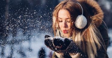 A woman with beautiful skin enjoying the snowy winter season