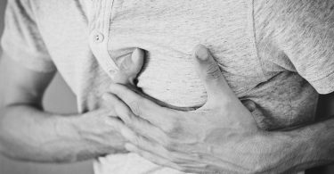 Person experiencing chest pain