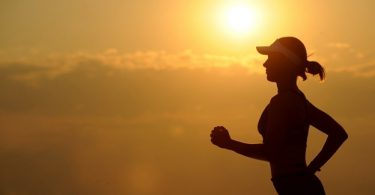 A Runner's Profile During Sunset