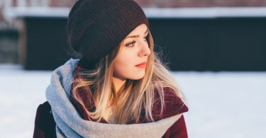 Woman wearing winter clothing with perfect eyebrows.