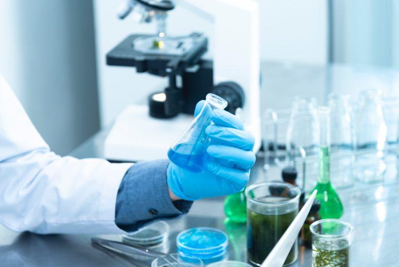 scientist using lab apparatus, representing animal testing in laboratories