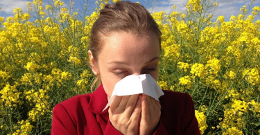 A woman dealing with a seasonal allergy.