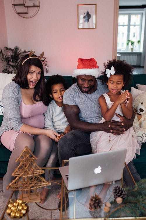 A happy family consulting a virtual doctor for their children.