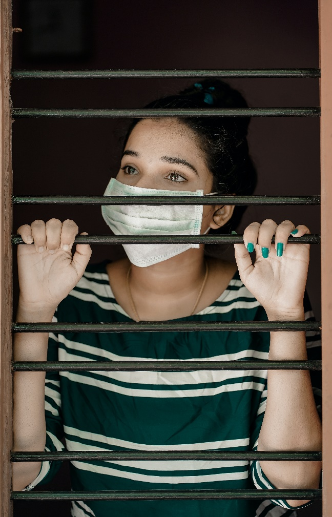 woman-covering-her-face-with-mask