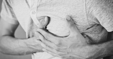 A person holding their chest due to pain