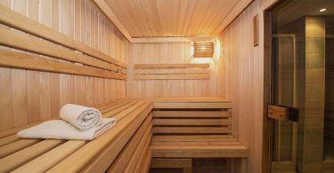 Two Towels Resting on A Sauna Bench