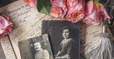 Pictures of ancestors with some letters and old flowers.
