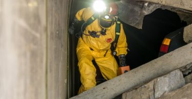 A worker navigating his route through a tunnel