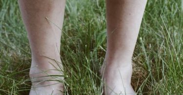 person standing in grass