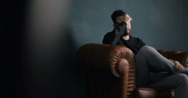 A man sitting alone
