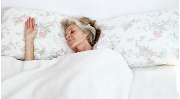 A older woman sleeping