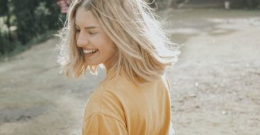 A happy woman enjoying the sunshine