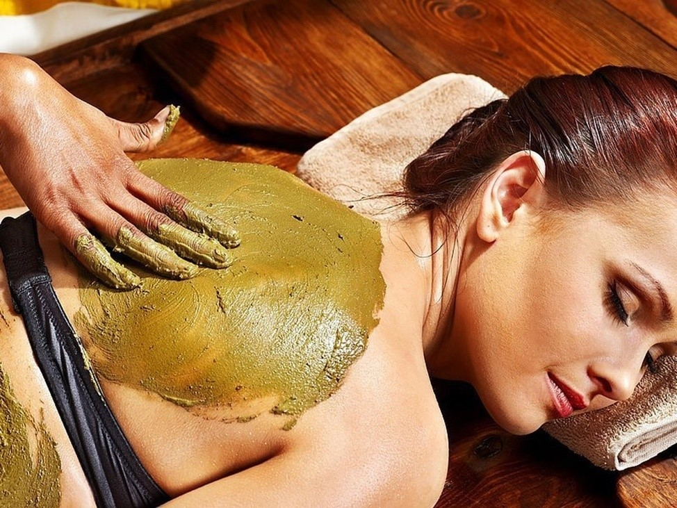 A person getting a body wrap treatment at a spa