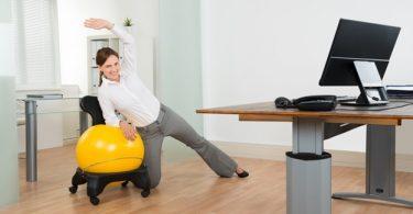 woman using desk exercise equipment