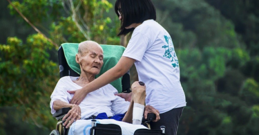a girl helping an old person