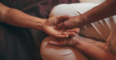 a person receiving a hand massage