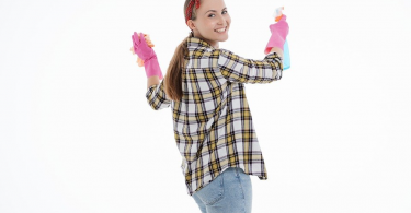 A woman wearing gloves and cleaning