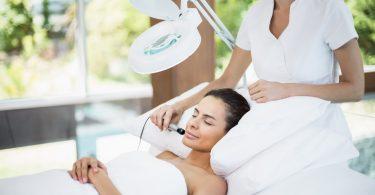 A woman receiving facial massage
