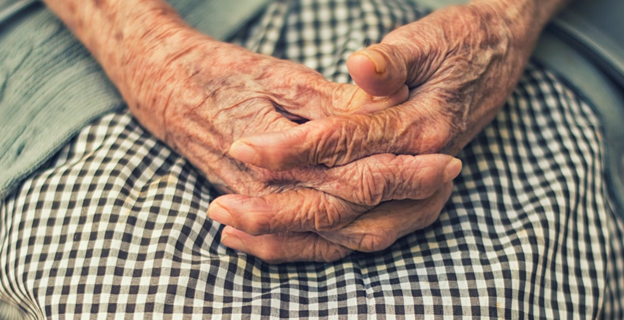 A close up of a woman's wrinkly hands