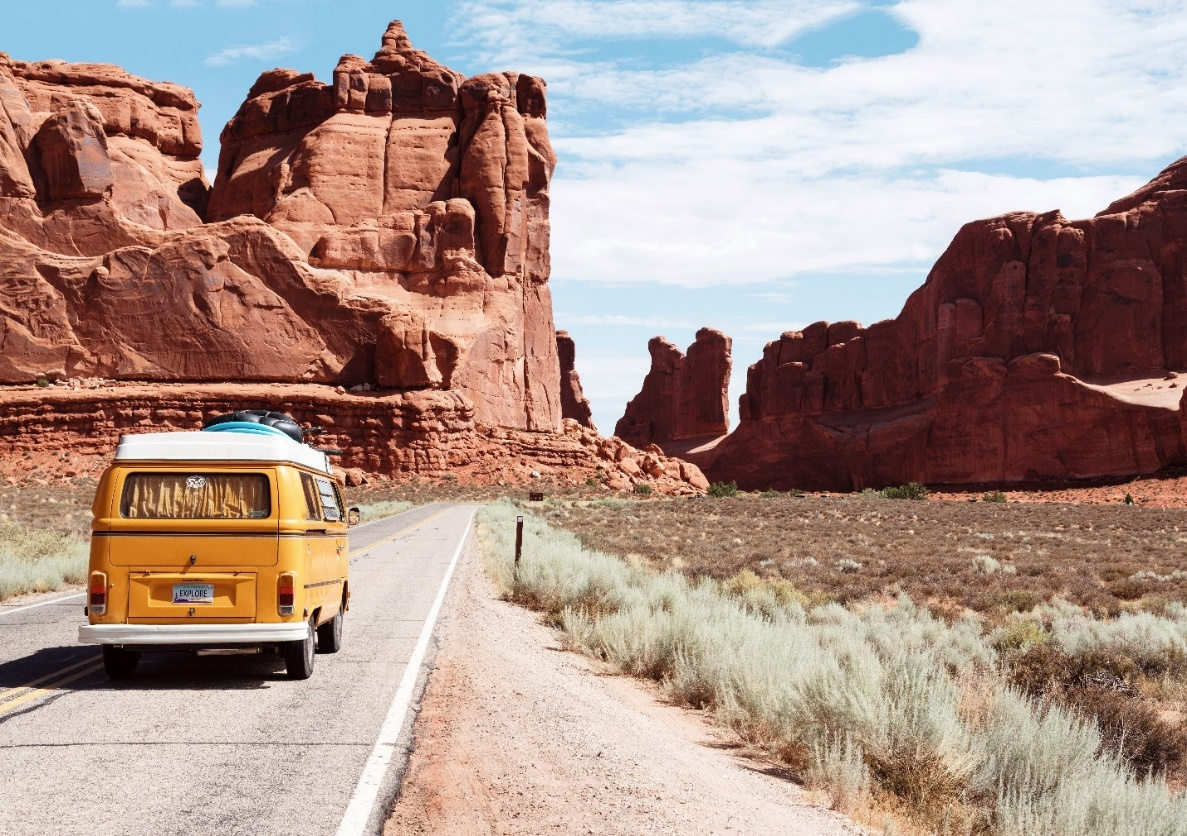 A yellow van on a road trip