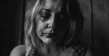A grieving woman