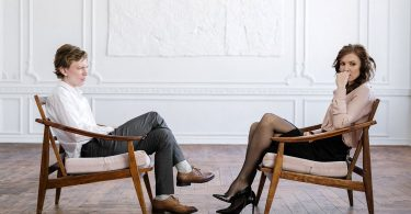 A man and woman getting couple's therapy