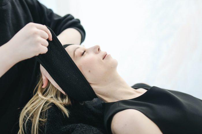A woman before an LED facial treatment in Palm Desert