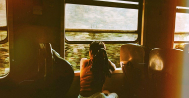 woman riding a train after taking motion sickness relief