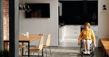 Woman in a wheelchair at home.