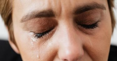 A victim of emotional abuse crying