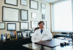 doctor in his office sitting at his desk