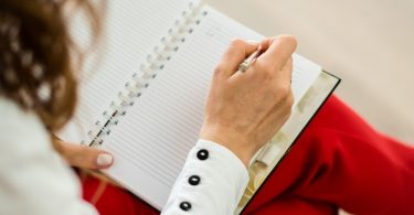 A mental health expert making notes