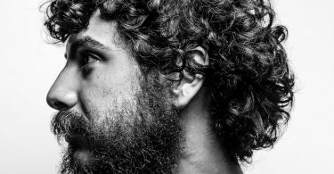 Profile View of a Bearded Man with A Full Head of Curly Hair