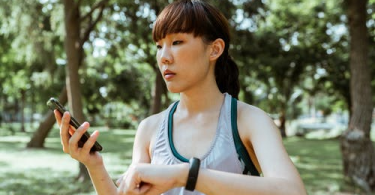 a woman using her fitness tracker