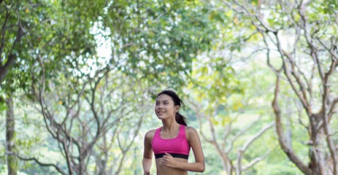 a woman running in the part